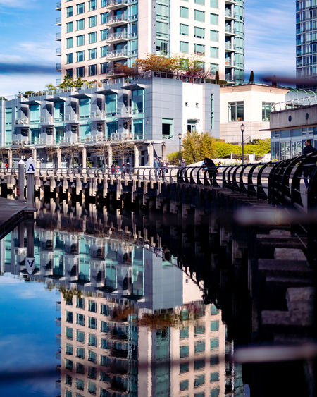 Architecture Built Structure Building Exterior City Building Bridge Connection Bridge - Man Made Structure Water Day Reflection Nature No People Transportation Residential District Sky Outdoors City Life Office Building Exterior Canal Arch Bridge Skyscraper Apartment
