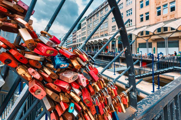 Low angle view of padlocks on bridge