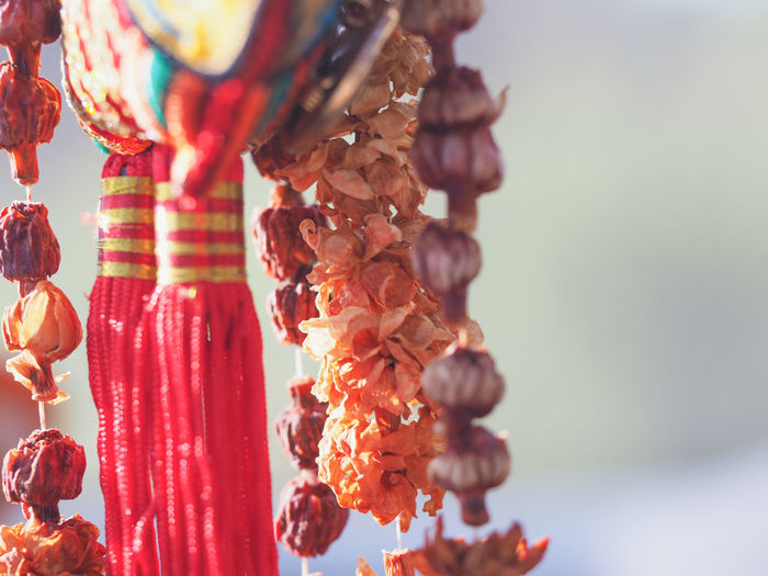 Close-Up Of Decoration With Floral Garlands