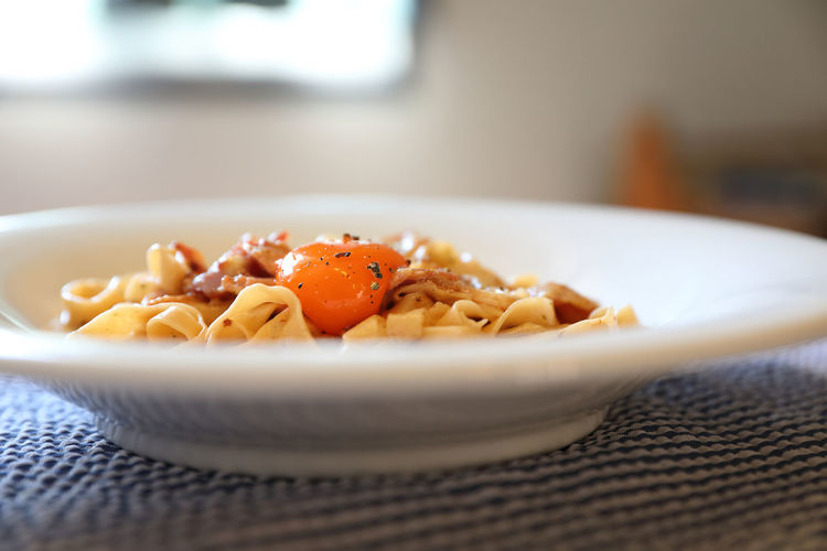 Egg Yolk Homemade Pasta Homemade Food Food Food And Drink Freshness Ready-to-eat Pasta Healthy Eating Italian Food Wellbeing Indoors  Still Life Serving Size Table Plate Focus On Foreground Bowl Indulgence Garnish Spaghetti Temptation Place Mat