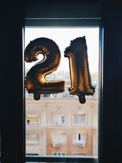 Close-up of number on window