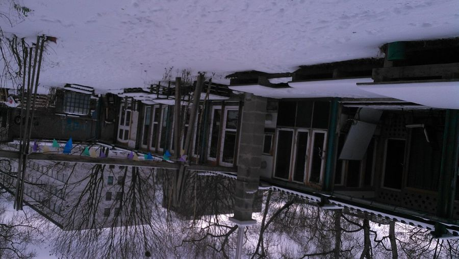 Snow covered houses by building