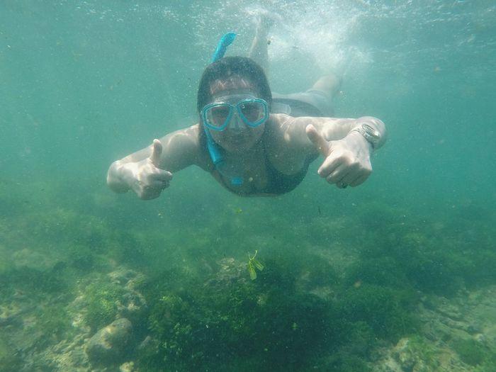 Portrait of woman swimming undersea