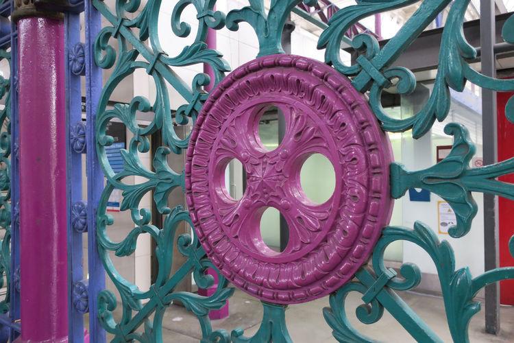 Close-up of pink machine part