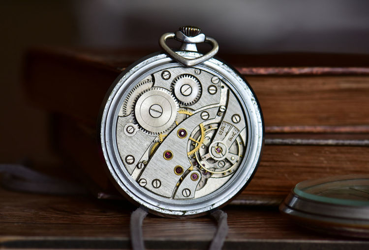 Close-up of pocket watch machinery on table