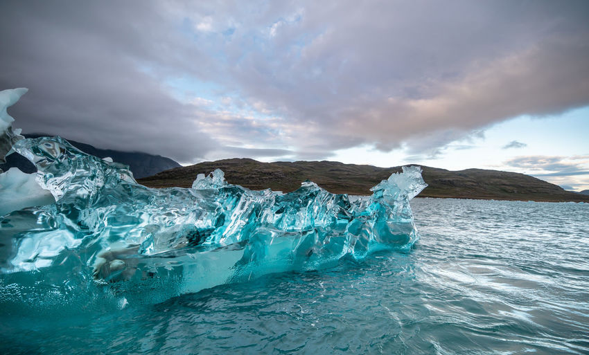 Blue ice in Greenland Iceberg - Ice Formation Ice Sea Cloud - Sky Clear Ice Ice Turquoise Scenics - Nature Nordic Countries Arctic