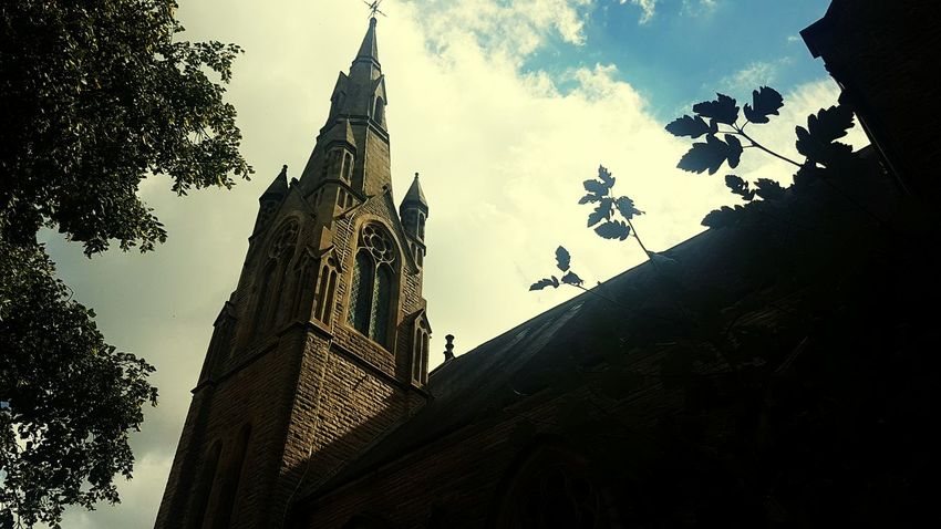 Architecture Architecture Spirituality Place Of Worship Religion Building Exterior Church Built Structure Low Angle View Religion Tree Sky Religion Cathedral Steeple Spire  Cloud Outdoors Temple - Building Cloud - Sky Day