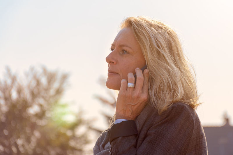Woman Looking Away While Talking On Mobile Phone