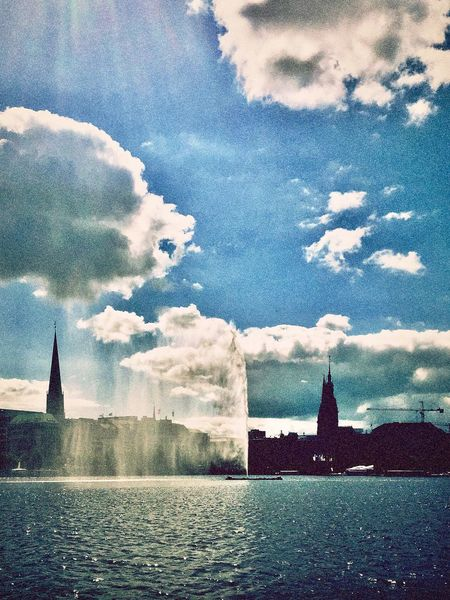 alster_fountain. Architecture City Fountain Alster Alsterfontäne Hamburg Hamburgmeineperle Cloud - Sky Sky Built Structure Building Exterior Water Weather No People Skyline Waterfront Cityscape Horizon Over Water Silhouette Hamburgcity Alster View Light And Shadow Sunlight Sunday On The Water