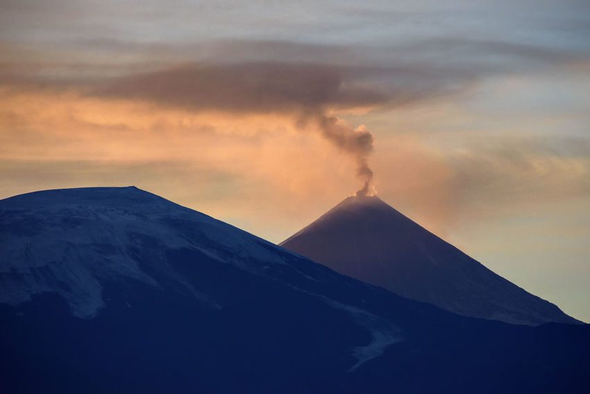 Smoking volcano at Kamchatka (Kluchevskatya sopka) Beauty In Nature Cloud - Sky Day Erupting Far East Kamchatka Landscape Mountain Mountain Peak Nature No People Outdoors Power In Nature Russia Scenics Sky Smoke - Physical Structure Tranquil Scene Volcano