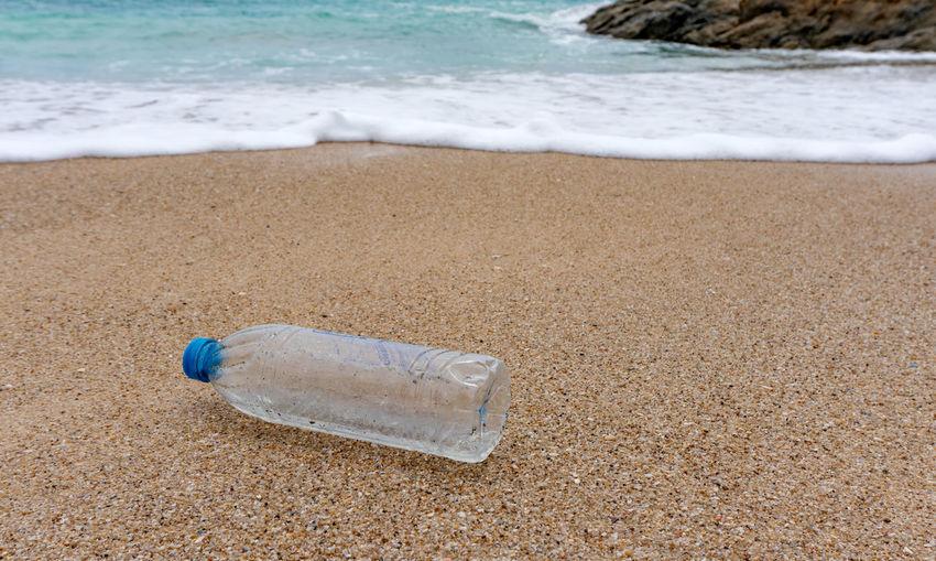 Plastic bottle on sand at beach