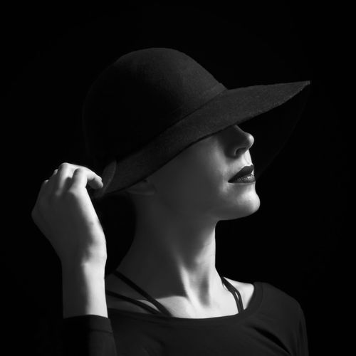 Adult Adults Only Beautiful People Beautiful Woman Beauty Black Background Close-up Day Hat Headshot Headwear Indoors  Mid Adult One Person One Woman Only One Young Woman Only Only Women People Portrait Studio Shot Women Young Adult