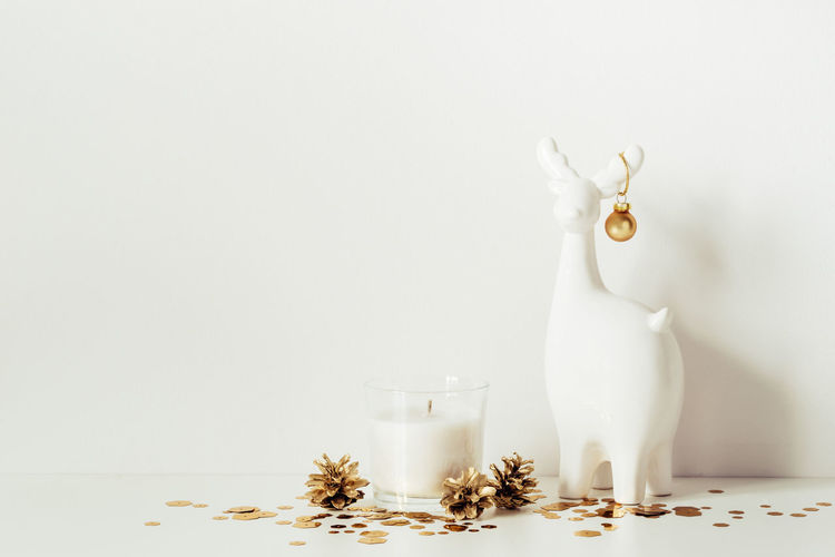 Close-up of white animal representation on table
