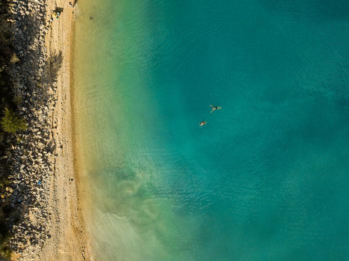 High angle top down view of beach and lake