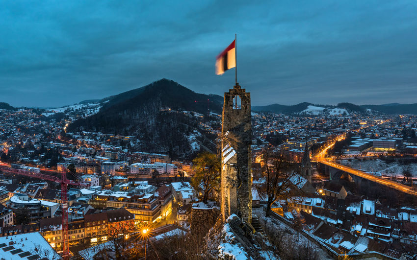 Baden ist. City Lights Blue Hour Architecture Flag Ruins Built Structure Cold Temperature Winter Sky Snow Illuminated Cityscape Building Building Exterior Hill Clouds Traffic