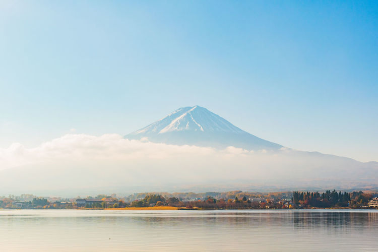 beautiful scene of kawaguchi lake in autumn season with cloud on village Japan Kawaguchiko Mount FuJi Mt.Fuji Tokyo Beauty In Nature Fuji Lake Lake View Mountain Mountain Peak Nature Outdoors Sky Snow Snowcapped Mountain Tranquil Scene Tranquility Travel Destinations Volcano Water Winter