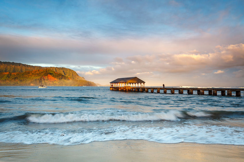The famous Hanalei Bay at sunrise, on the island of Kauai. Hanalei Hanalei Bay  Hanalei Pier Hawaii Kauai Pier Beach Beauty In Nature Cloud - Sky Famous Place Mountains Nature Outdoors Princeville Scenics Sea Sky Sunrise Tranquil Scene Tranquility Travel Destinations Vacations Water