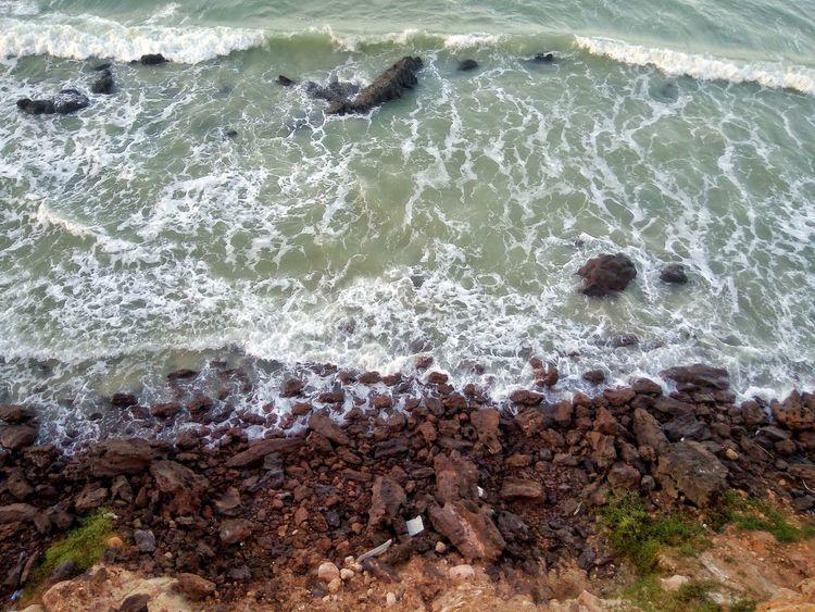 Shore in Natal, Rio Grande do Norte. Water Beach High Angle View Close-up Rushing Shore Pebble Beach Wave Rocky Coastline Ocean Calm Tide Sea Pebble Crashing