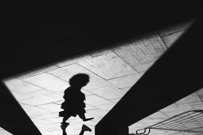 Shadow of person walking on floor