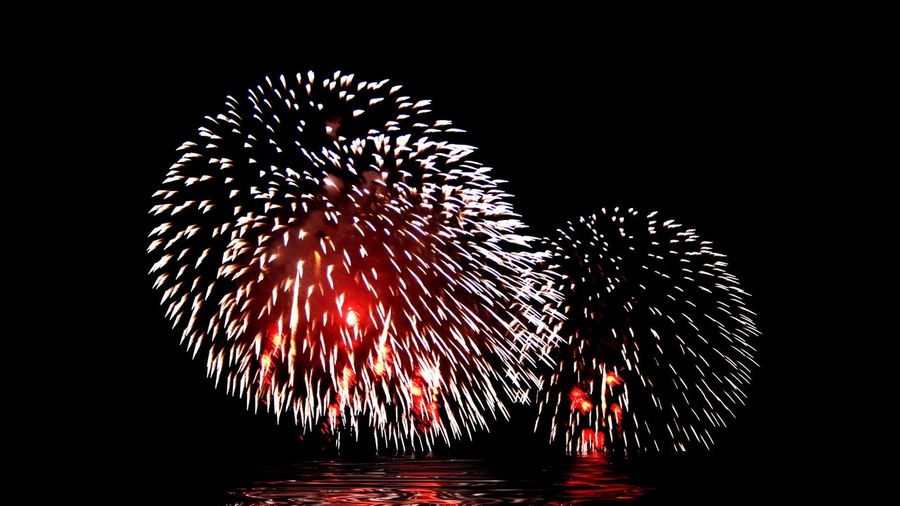 Fireworks display. Night Long Exposure Motion Firework Display Exploding Blurred Motion Celebration Firework - Man Made Object Red Illuminated No People Water Black Background Sky Independence Day 4th Of July Fireworksphotography Fireworks Celebration Celebrate Fireball Marylandisforcrabs🦀 The Great Outdoors - 2017 EyeEm Awards Sommergefühle