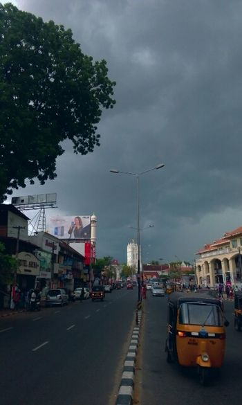 Cloud - Sky Outdoors Sky Day Clouds Dark Clouds Rainy Days ChurchCar Trivandrum Trivandrumdiaries Trivandrumdiaries India Cityscape Cityphotography Cityspaces City Business Finance And Industry One Person People