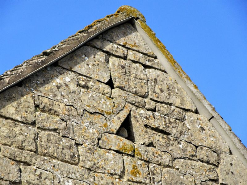 Triangular vent in an old barn Apex Architecture Barn Building Exterior Built Structure Clear Sky Day Eaves History Low Angle View No People Outdoors Roof Sky Triangle