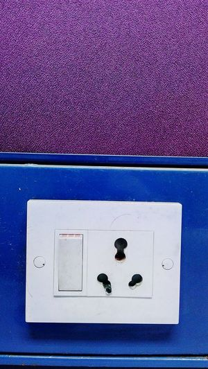 Switch Board Plug & Switch Burnt Indoor Inside Room Two Colours Purple & Blue Close-up Mobile Photography SSClicks SSClickPics