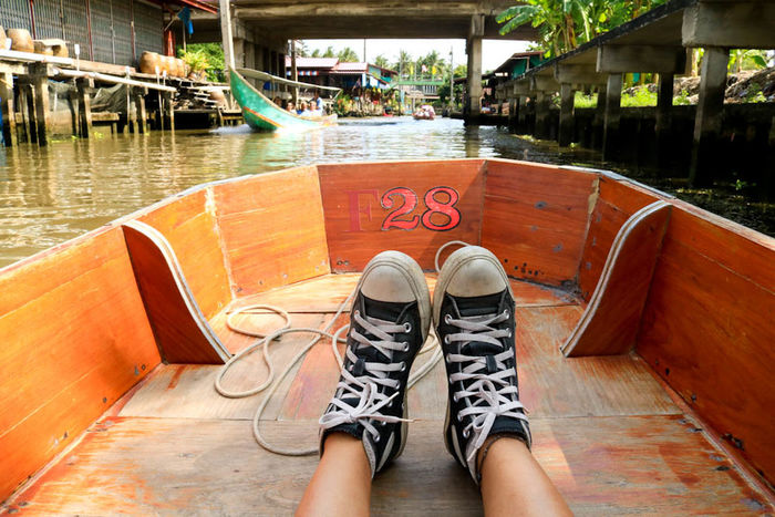 The Journey Is The Destination it's me and my sneakers. This shot was taken at the Damnoen Saduak Floating Market in Thailand, more than an hour away from Bangkok. I always have a photo like this wherever I go, just to show that me and my sneakers are travel buddies. Travel Travel Photography Floating Market Thailand Sneakers Fresh On Market July 2016 Eyeem Market On The Boat Tourism
