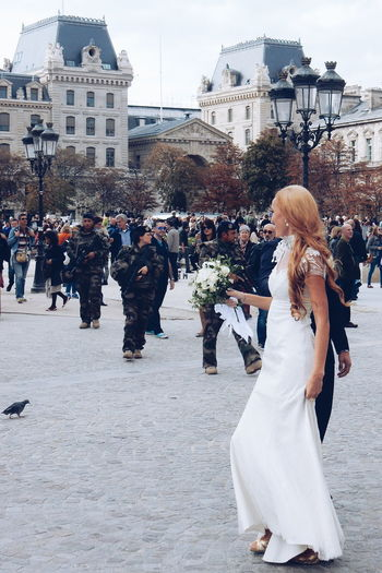 In Paris city you notice all the newlyweds and tourists from all over the world. You see them at the Eiffel Tower, by the Seine and many other places. I captured this happy newlyweds (from Russia i guess) at the Notre Dame Square surrounded by other tourists... but also by security guards because of the big terrorist threat in the city...i felt it was a very special moment and i was wandering what the newlyweds was feeling... only happiness? The Tourist Paris Newlyweds Tourists