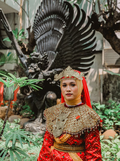 Portrait of young woman in costume standing outdoors