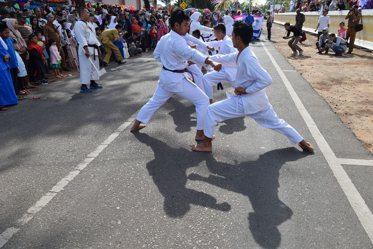 Men Practicing Karate On Road During Festival