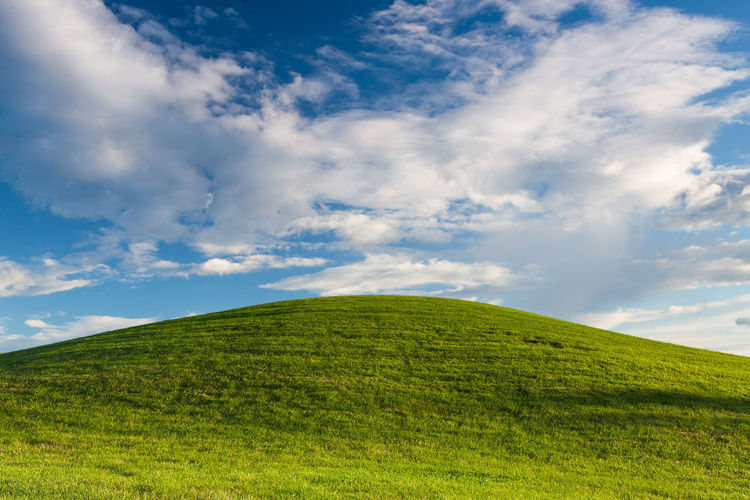 The hill Landscape_Collection Nature Beauty In Nature Blue Cloud - Sky Day Empty Grass Green Color Growth Hill Idyllic Landscape Nature No People Nobody Outdoors Scenics Sky Skyscraper Summer Symmetry Tranquil Scene Tranquility