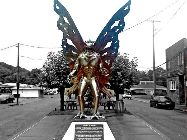 Mothman Mothmanchronicles Statue Mythology Mythological Mythological Creature Cryptozoology Point Pleasant West Virginia Color Splash Red Eyes Gold Statue Large Wings