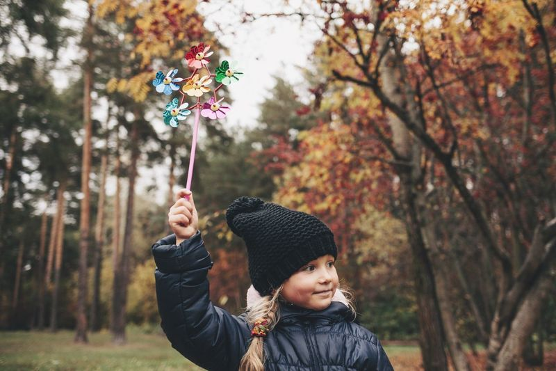 Tree Real People One Person Leisure Activity Focus On Foreground Headshot Boys Day Knit Hat Outdoors Smiling Autumn Warm Clothing Lifestyles Happiness Childhood One Boy Only Nature People Adult Fall Fall Colors Childhood Memories Child Little Girl