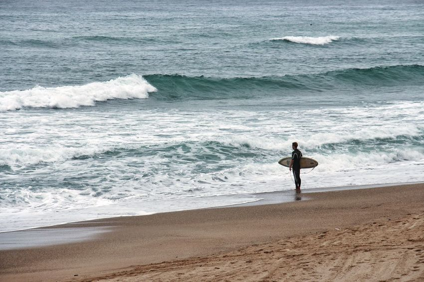 """"""" Taunting Poseidon """" Alone Surf Beach Beauty In Nature Day Full Length Horizon Over Water Lifestyles Men Motion Nature One Man Only One Person Only Men Outdoors Real People Sand Scenics Sea Shore Sport Standing Surf Surfing Vacations Water Wave Waves"""
