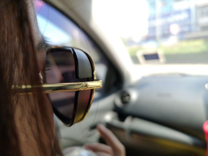 Reflection of man in car mirror