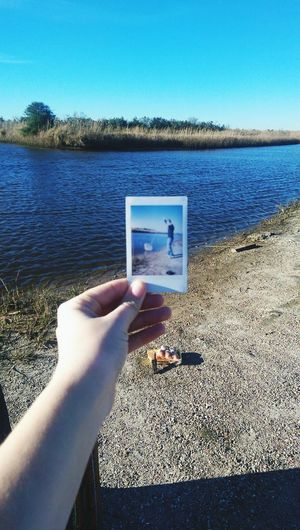 The Portraitist - 2017 EyeEm Awards Human Body Part Human Hand Lake One Person Sky Water Outdoors People Nature Day Clear Sky Horizon Over Water Close-up Adult Only Men Adults Only Crabbing Fishing Beauty Summer Sunlight Tranquil Scene Poloroid Poloroidpicture Live For The Story Summer Exploratorium