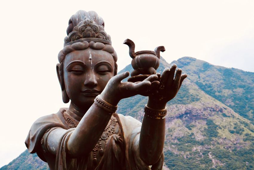One of the six Devas - Incense offering Buddhism HongKong Temple Travel Destinations Incense Sculpture Statue Art And Craft Religion Human Representation Belief Representation Spirituality Sky Nature Architecture Day Mountain Place Of Worship Outdoors