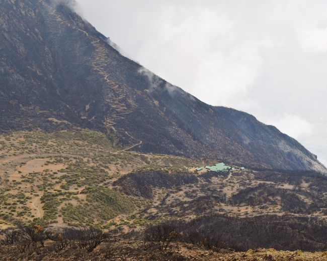 Saddle Hut and the meandering trail of Little Meru seen from Mount Meru, Arusha National Park, Tanzania Mountains Mountainclimbing Fog Hike Nature Adventure Hiking Mount Meru Arusha National Park Little Meru Saddle Hut Mountaineering Travel Destinations Travel Photography Travel Landscape Mountain Rural Scene Sky Landscape Cloud - Sky