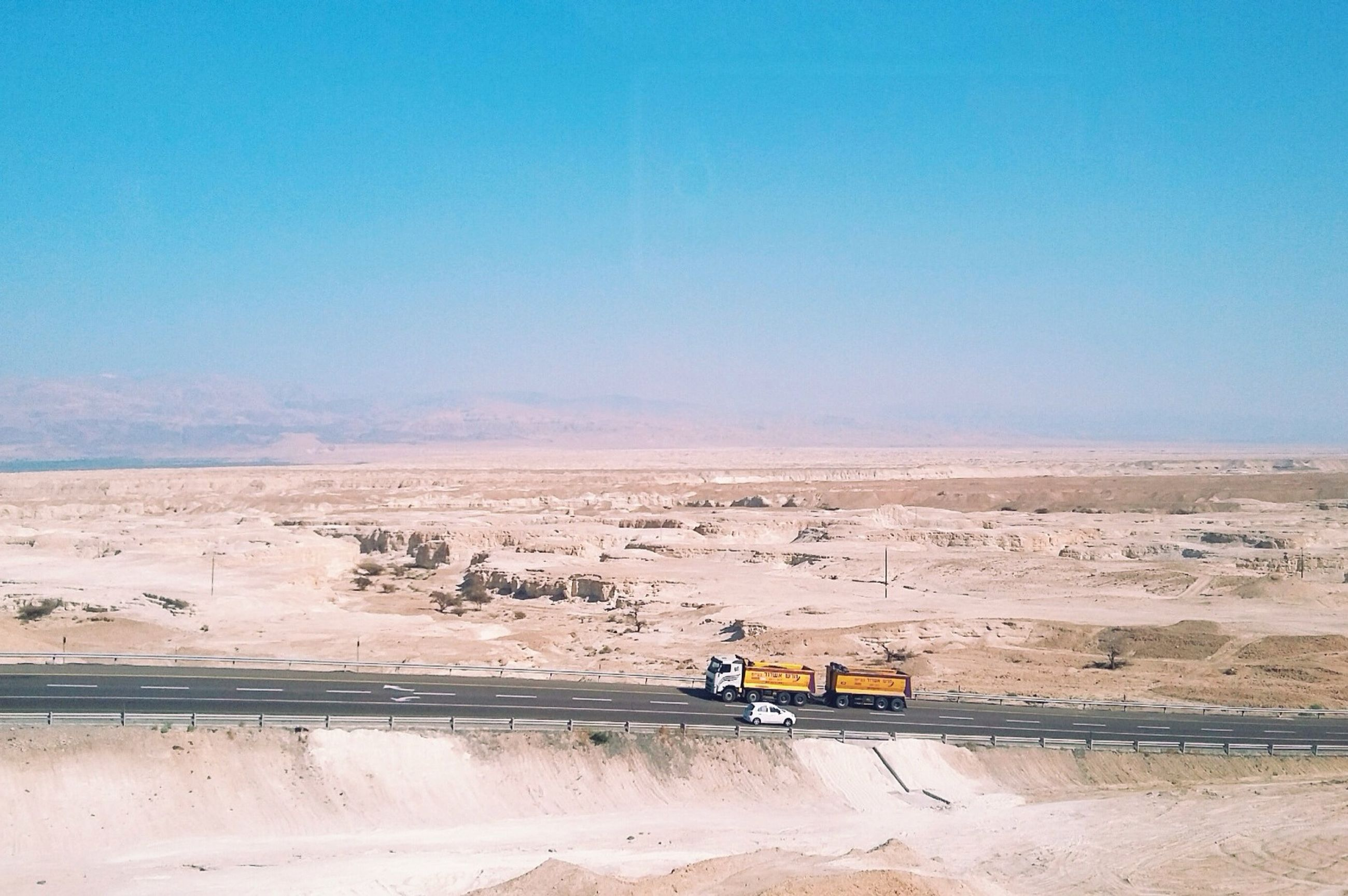 clear sky, sand, copy space, beach, transportation, blue, tranquility, tranquil scene, nature, landscape, scenics, shore, mode of transport, outdoors, sunlight, sky, beauty in nature, day, no people, non-urban scene