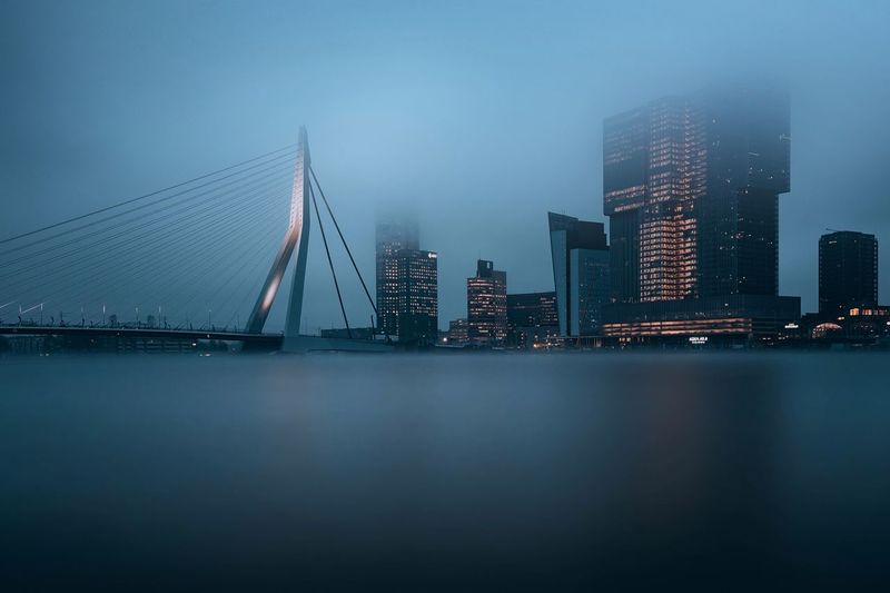 Foggy Rotterdam Cityscape EyeEmNewHere Long Exposure Holland Netherlands Rotterdam Mist Fog Foggy Built Structure Architecture Water City Building Exterior Office Building Exterior Illuminated Skyscraper Waterfront Sky Travel Destinations Building Nature Night Modern Tall - High No People Sea Outdoors Cityscape