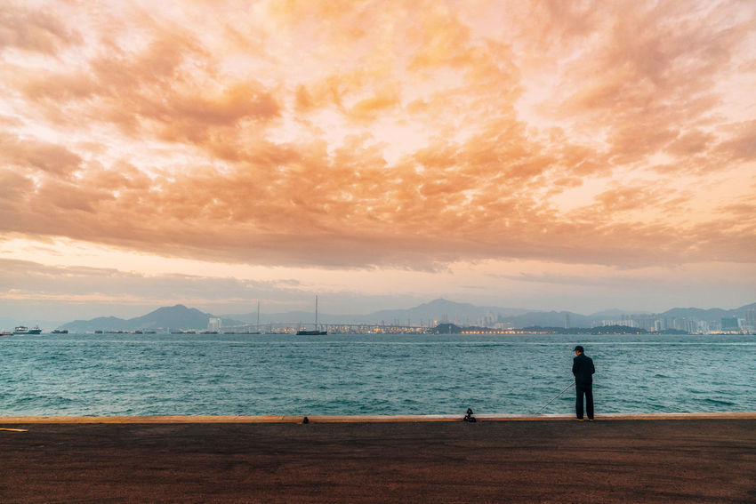 Beach Beauty In Nature Cloud - Sky Day Full Length Horizon Over Water Lifestyles Men Mountain Nature Nautical Vessel One Person Outdoors People Real People Scenics Sea Sky Standing Sunset Tranquil Scene Tranquility Water