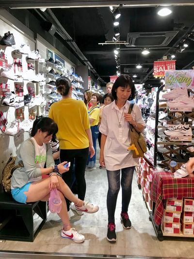 Full Length Retail  Women Real People Indoors  Store Shopping Men Lifestyles Group Of People People Customer  Consumerism Adult Standing Casual Clothing Market Choice Leisure Activity Supermarket Buying Sale Hairstyle
