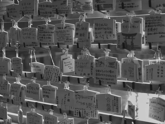 Close-up of wooden wishing plaques at Itsukushima Shrine in the early morning light Japanese  Miyajima Shrine Worship Abundance Communication Culture Full Frame Good Wishes Handwriting  Hanging Information Itsukushima Label Large Group Of Objects Message No People Non-western Script Prayers Script Shinto Still Life Text Wishing Wooden Plaques
