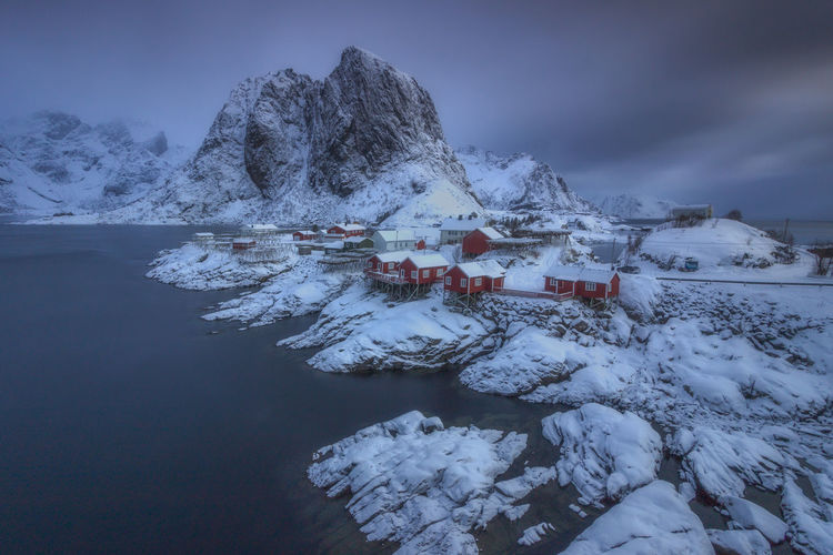 Hamnoy, Lofoten, Norway Fjordland Norway Lofoten Islands Architecture Beauty In Nature Building Built Structure Cloud - Sky Cold Temperature Fjord Frozen Hamnøy House Lofoten Mountain Nature No People Outdoors Scenics - Nature Sky Snow Snowcapped Mountain Tranquil Scene Tranquility Water Winter