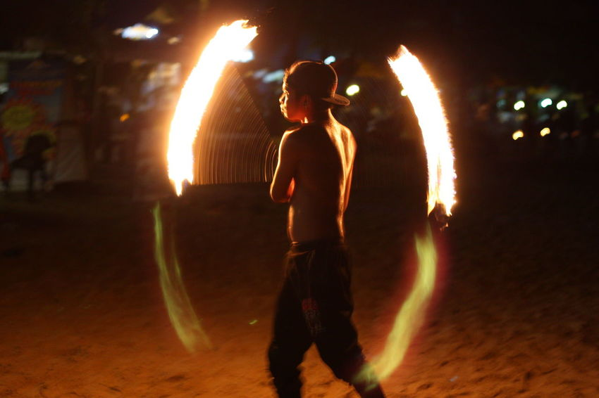 Arts Culture And Entertainment Beach Dancing Danger Fire Dancer Firework - Man Made Object Flame Glowing Heat - Temperature Illuminated Leisure Activity Long Exposure Men Motion Night Outdoors Performance Performing Arts Event Real People RISK Shirtless Skill  Standing