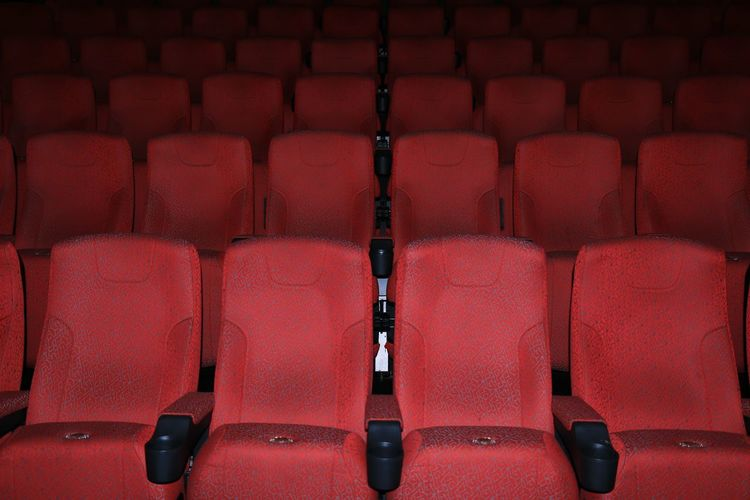 Empty red seats at movie theater