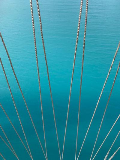 Full frame shot of rope against blue sea