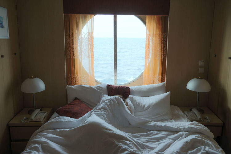 Bed Sea Window Bedroom Furniture Indoors  Horizon Over Water Relaxation Water Pillow Day Home Interior Scenics - Nature Horizon Comfortable Nature Sunlight Glass - Material Hotel Room Luxury Cruise Cruise Ship Backlit Sleep One Woman Only One Person Nap Vacation Travel Travelling Resting Ocean Ocean View Comfort My Best Photo
