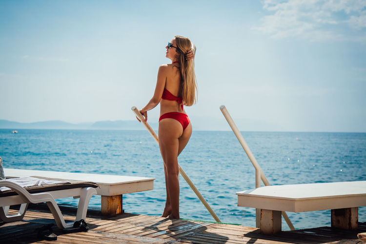 Water Sea Young Adult Sky Young Women One Person Full Length Lifestyles Beauty In Nature Swimwear Adult Nature Beautiful Woman Leisure Activity Women Chair Horizon Day Bikini Fashion Horizon Over Water Outdoors